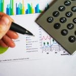 pen with calculator - Dan Moisand discusses what to expect from financial markets